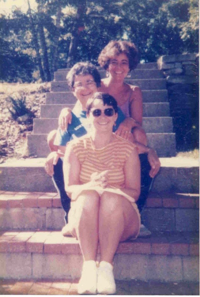 Alice Larsen sits between her daughters Janice Powers, front, of Westbrook and Carol McNaboe of Standish at a family gathering in 1985.
