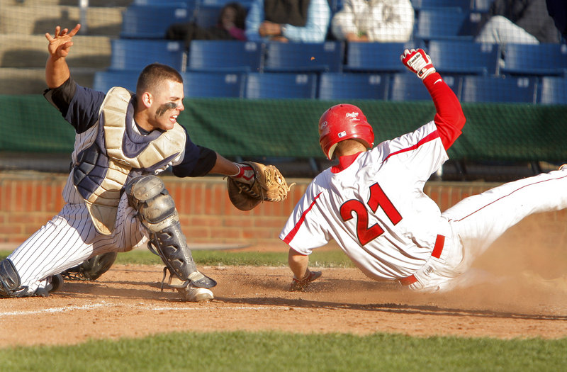 Portland catcher Nick Volger sweeps the tag in time to nab Ben Wessel of Scarborough, who was attempting to score Tuesday during Scarborough's 5-3 victory at Hadlock Field. Wessel drove in the tie-breaking run with a triple in the seventh inning.