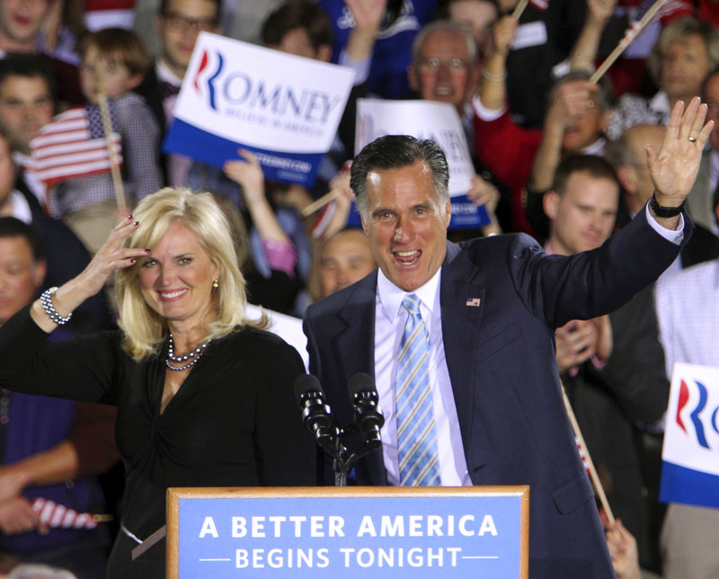 GOP presidential candidate Mitt Romney and his wife, Ann, wave to supporters Tuesday in Manchester, N.H. Romney won primaries in five Northeastern states Tuesday.