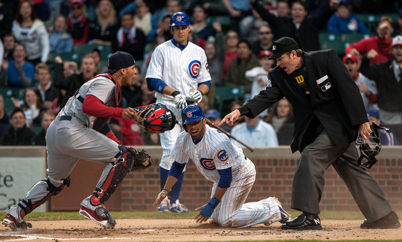 Cards catcher Yadier Molina is not happy after umpire Chris Conroy calls David DeJesus of the Cubs safe Tuesday night.