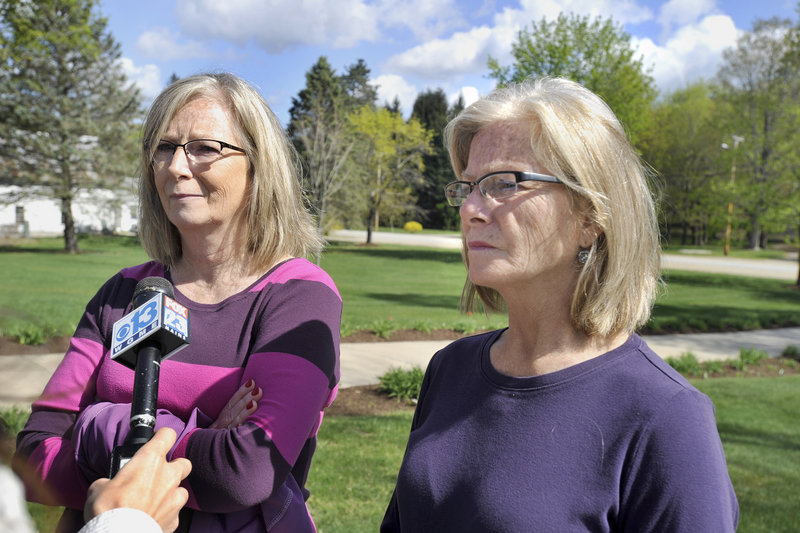 Cheryl Boucher, left, and Lynn Fortin, sisters of Roger White, the victim of a weekend slaying in Old Orchard Beach, speak to reporters Wednesday after an arraigment hearing at York County Courthouse for Michael Swenson. Cheryl Boucher of Alfred described White as a good brother, the father of two, the grandfather of two and a man who lived life on his own terms.