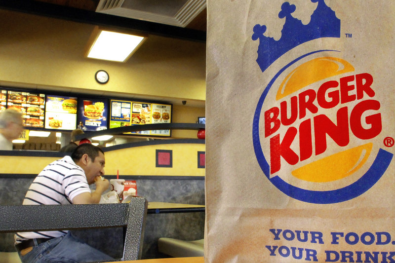 Patrons dine at Burger King in Springfield, Ill. The world's second-biggest fast-food chain announced Wednesday that by 2017, all of its eggs and pork will come from cage-free chickens and pigs.