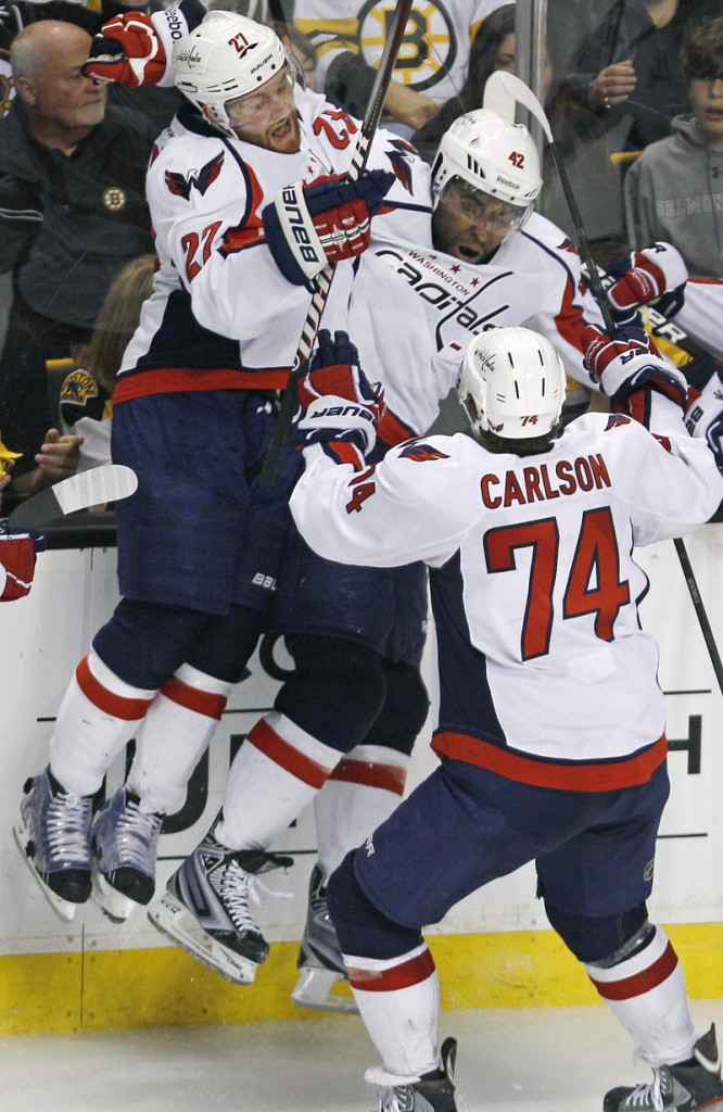 Joel Ward, center, gets mobbed by teammates after scoring the OT goal in Game 7 Wednesday night that gave the Capitals a 2-1 win over the Bruins in Boston.