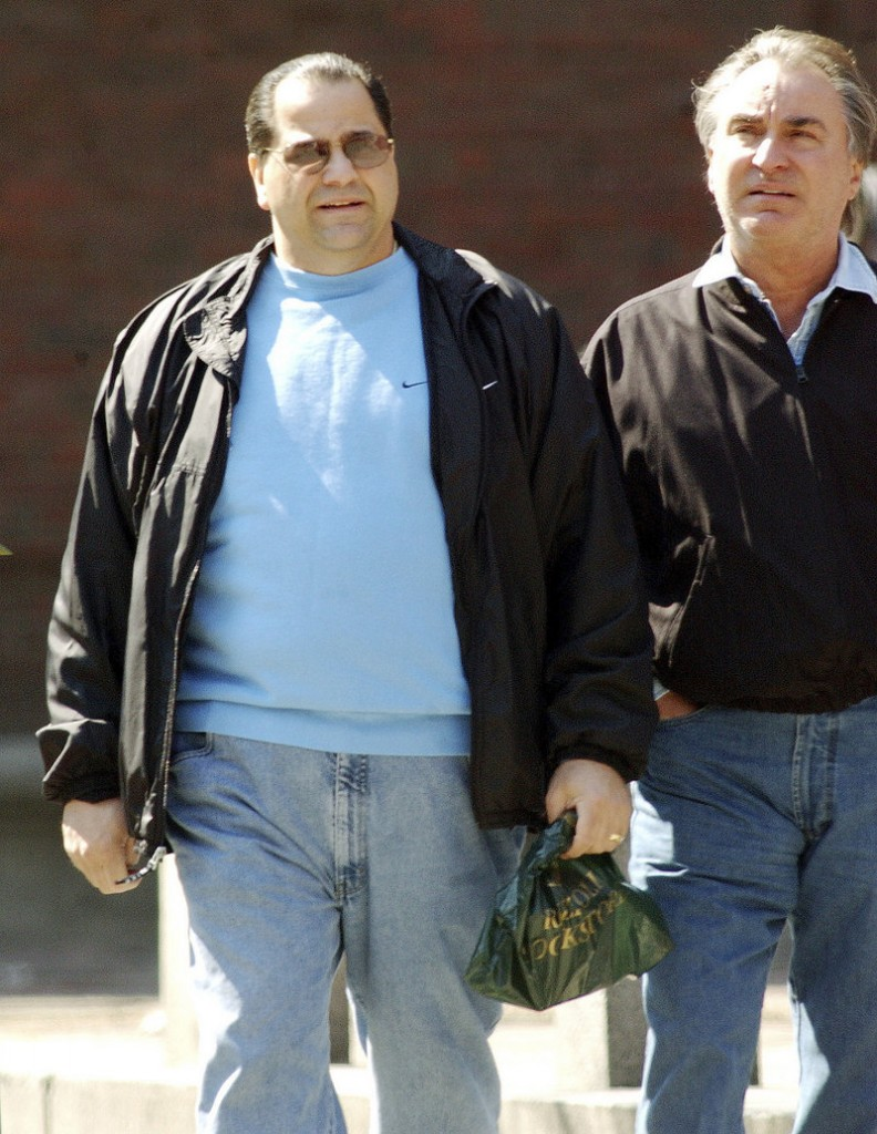 Reputed New England mafia leader Anthony DiNunzio, left, walks with Anthony Gambale, right, on Hanover Street in Boston's North End in 2002. DiNunzio was taken into FBI custody Wednesday.