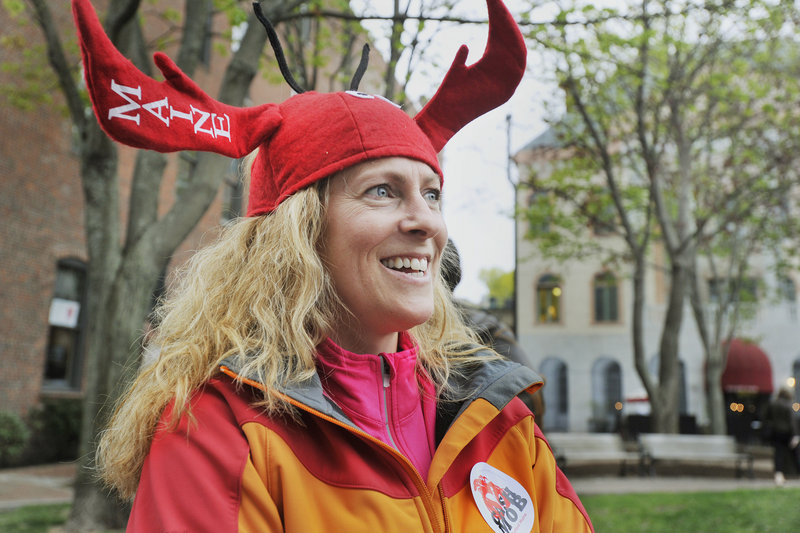 Suzanne Hawley and her family were visiting Portland from their home in New Boston, N.H., and decided to take part in the cash mob event at Lisa-Marie's Made in Maine on Thursday evening. Marketing agency Local Thunder gave her a lobster hat to wear.