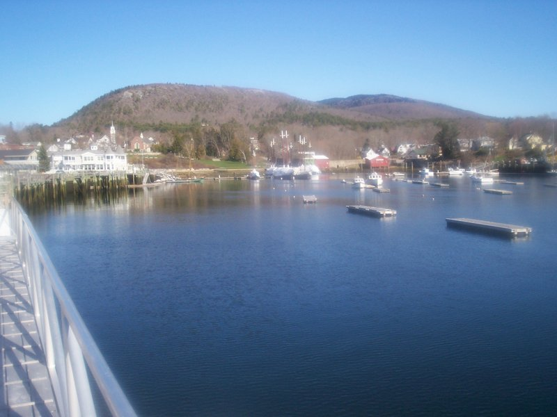 """Camden Harbor is quiet this time of year, perfect for kayaking. And the view from the water level renders even the familiar Camden Hills, """"where the mountains meet the sea,"""" completely new."""