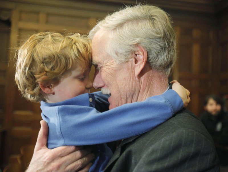 Former Gov. Angus King speaks to his grandson Gus King in March after announcing his intention to run for Sen. Olympia Snowe's Senate seat.