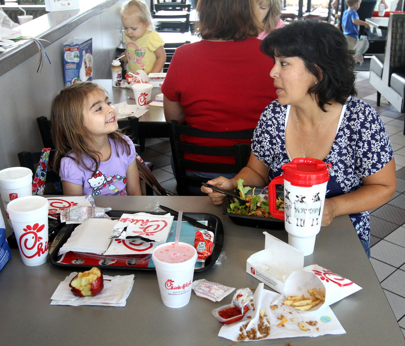 """Orlando mom Cindy Metzger dines out at a Chick-Fil-A restaurant with 6-year-old daughter Ava who, Metzger said, """"all of a sudden one day wanted to have the numbered meals"""" instead of kids' meals."""