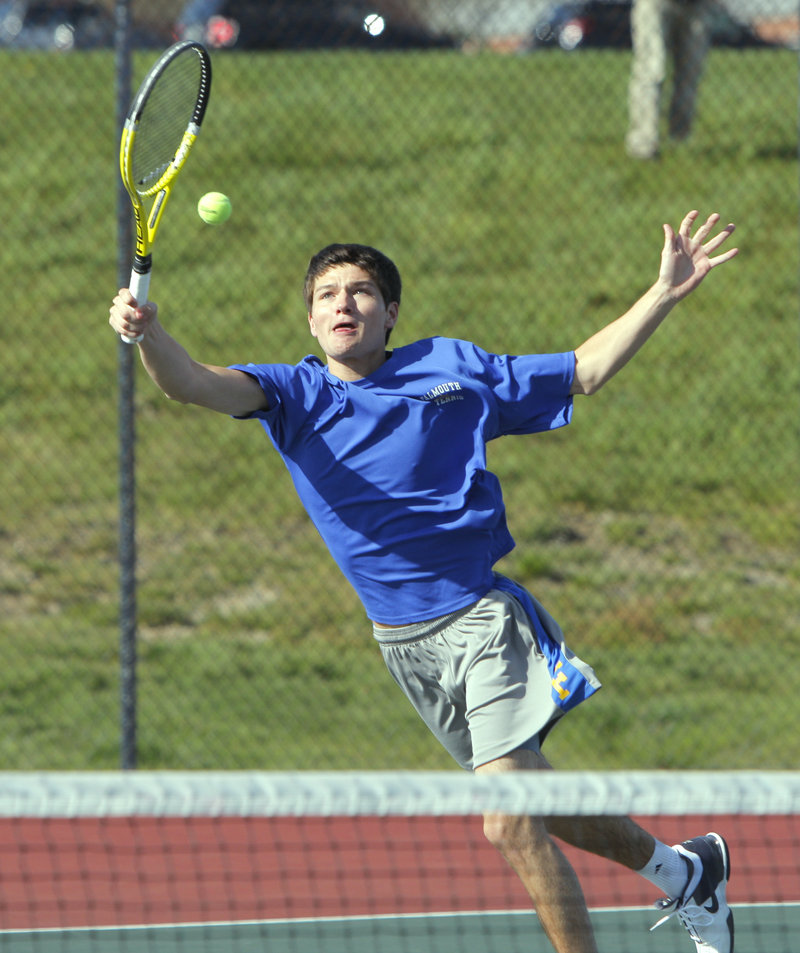 "Justin Brogan of Falmouth stretches for a return during his match against Cape Elizabeth's Matt Gilman. Brogan said the blustery conditions at the Cape Elizabeth High courts were ""like playing in a wind tunnel."""