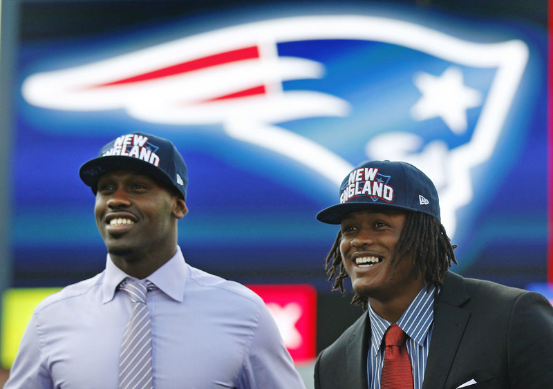 Chandler Jones, left, and Dont'a Hightower, the Patriots' two first-round draft picks, smile as they are introduced at Gillette Stadium on Friday.
