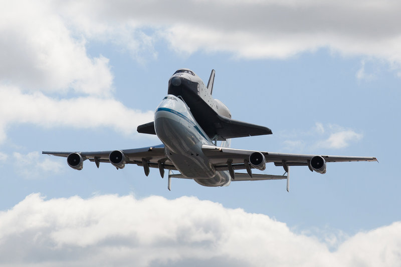 The space shuttle Enterprise, on the back of the NASA 747 Shuttle Carrier Aircraft, flies over New York on its last flight before it becomes a museum piece.