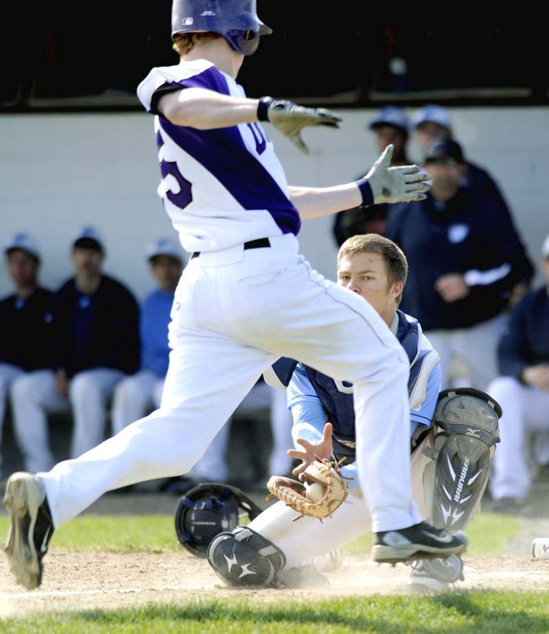 Westbrook catcher Kyle Heath prepares to tag out Deering's Trey Thomes, who was trying to score from first base on a double by Kenny Sweet. Westbrook went on to its fourth straight victory, 6-2.
