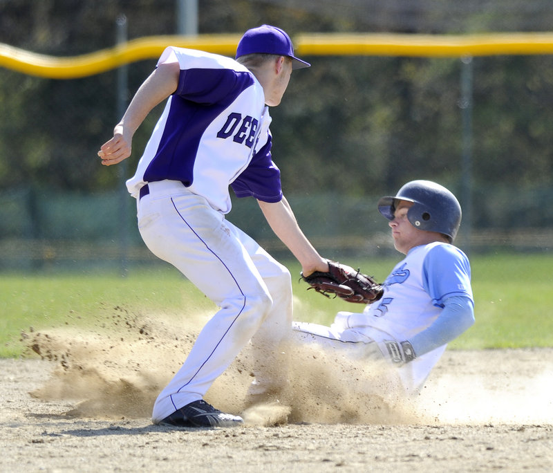 Kyle Heath slides safely into second base ahead of the tag by Deering's Luke Boyle. Heath's two-run double in the second inning put Westbrook ahead for good.