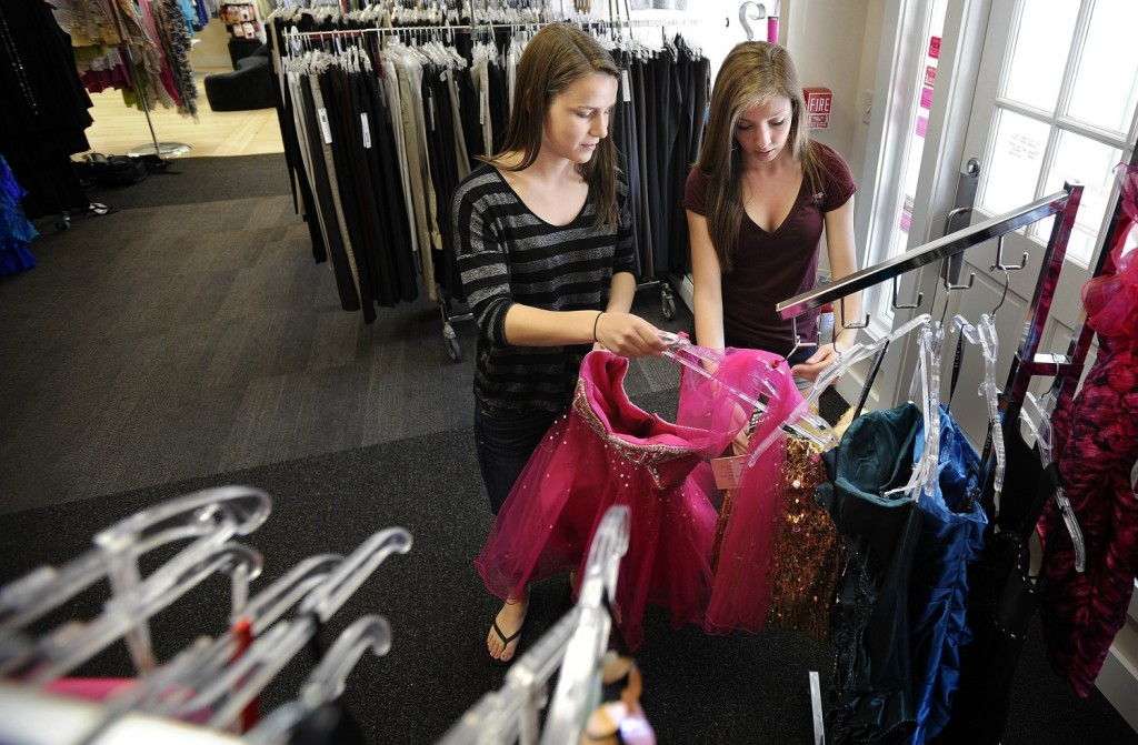 Scarborough High students Shelby Peterson and Breanna Battista look through the dress racks at Simply You Boutique in Saco. Gabe Souza/Staff Photographer