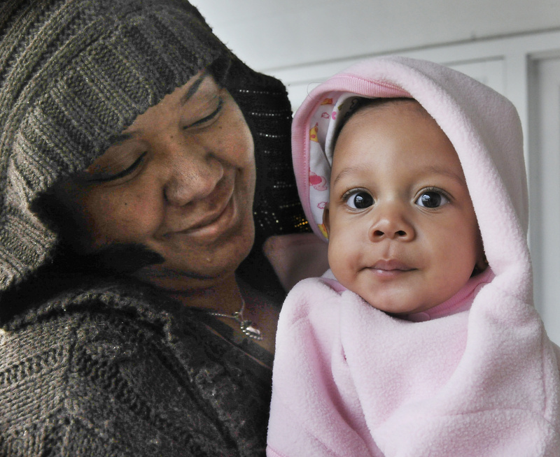 Esmeralda Vasquez, top, holds her 5-month-old daughter, Genesis, one of the girls from the Dominican Republic who arrived in Portland on Tuesday, a week before they are scheduled to have open-heart surgery at Maine Medical Center.