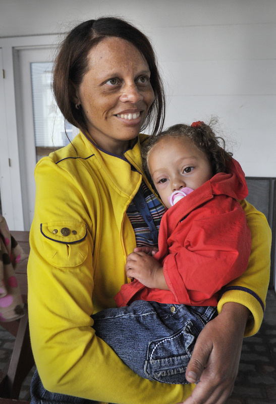 Dolores Mayi holds 21-month-old Daisy, one of two girls from the Dominican Republic who arrived in Portland on Tuesday to undergo open-heart surgery at Maine Medical Center. Arrangements for the surgeries were made through a Rotary program.