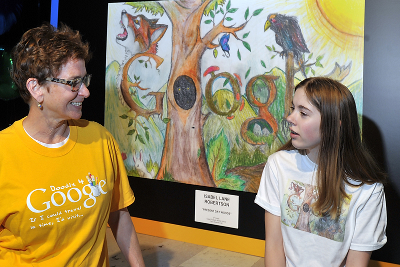 Isabel Robertson, an eighth grader at Cape Elizabeth Middle School, right, chats with her art teacher, Marguerite Lawler-Rohner, in front of her winning drawing before the start of an announcement by Google representatives today. She is one of fifty finalists in the country, one per state, who won a Google award for design. She is Maine's winner and will go to New York for the finals.
