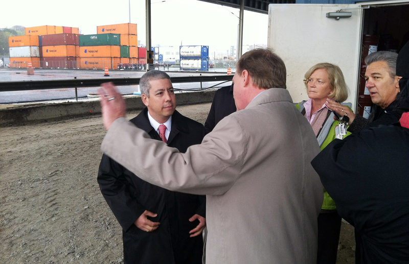 David Matsuda, left, who heads the the U.S. Maritime Administration, learns about infrastructure improvements being made at the International Marine Terminal from John Henshaw, executive director of the Maine Port Authority, and U.S. Rep. Chellie Pingree, D-1st District. Matsuda visited Portland and other Maine ports today. Jack Humeniuk, business agent for the International Longshoremen's Association Local 861, talks with Pingree in back.
