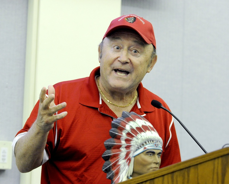 Former high school teacher and coach Roland Cote brought an Indian figurine with him as he spoke against giving up the