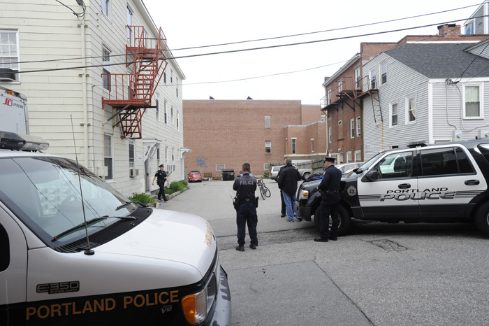 Portland police officers at the scene of a stabbing earlier today on Cedar Street.