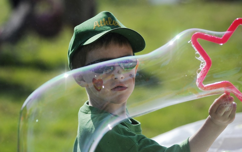 Trevor McDevitt, 6, of Biddeford watches a bubble he is making during the festivities of the American Heart Association's Southern Maine Heart Walk.