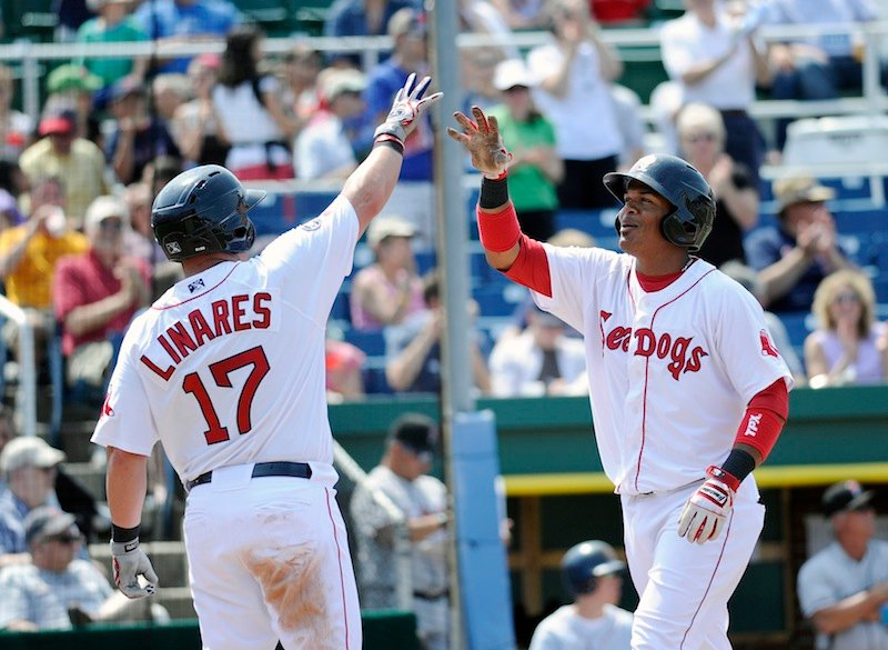 Portland's Juan Carlos Linares, left, greets Reynaldo Rodriguez at home plate after Rodriguez hit a two run home run in the bottom of the fourth inning Sunday, May 27, 2012 against the New Britain Rock Cats. The home run drove in Linares and was the start of a comeback as the Sea Dogs, who were down 4-0, came back to win 8-5.