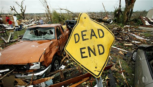 FILE-In this May 23, 2011 file photo, a mangled street sign stands among tornado debris in Joplin, Mo. City infrastructure including manhole covers and fire hydrants are among the $500 million in taxpayer assistance provided after an EF-5 tornado ripped through Joplin nearly a year ago,becoming the costliest tornado on record. (AP Photo/Charlie Riedel, File)