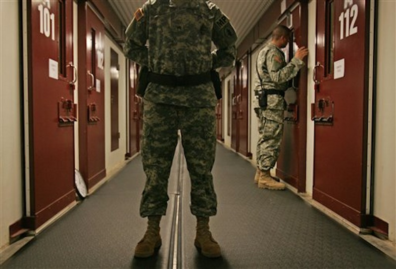 In this Oct. 9, 2007 file photo US military personnel inspect each occupied cell on a two-minute cycle at Camp 5 maximum-security facility on Guantanamo Bay U.S. Naval Base in Cuba. Many of the detainees at Guantanamo have been held since 2002. Five men accused of orchestrating the Sept. 11 attacks, including the self-proclaimed mastermind, are headed back to a military tribunal at Guantanamo Bay more than three years after President Barack Obama put the case on hold in a failed effort to move the proceedings to a civilian court and close the prison at the U.S. base in Cuba. (AP Photo/Brennan Linsley, File)