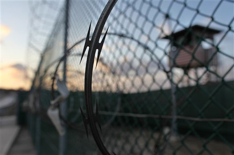 In this May 13, 2009 file photo reviewed by the U.S. military, the sun rises over the Guantanamo detention facility at dawn, at the Guantanamo Bay U.S. Naval Base, Cuba. In a speech Thursday, President Barack Obama defended his plans to close the Guantanamo prison camp. Five men accused of orchestrating the Sept. 11 attacks, including the self-proclaimed mastermind, are headed back to a military tribunal at Guantanamo Bay more than three years after President Barack Obama put the case on hold in a failed effort to move the proceedings to a civilian court and close the prison at the U.S. base in Cuba. (AP Photo/Brennan Linsley, file)