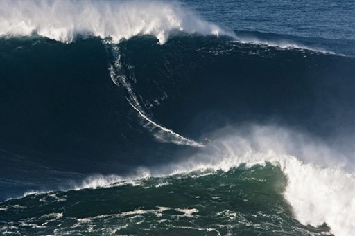 In this photo Nov. 1, 2011, photo, Garrett McNamara, of Hawaii, surfs what is being called the tallest wave ever ridden at the Praia do Norte beach in Nazare, Portugal. McNamara took away honors at the Billabong XXL Big Wave Awards Friday May 4, 2012 and also set a world surfing record for surfing a wave measured by experts as 78 feet. A panel of big wave surfing and photography experts, who analyzed and measured the photos and videos of Garrett's ride, determined the height of the wave.