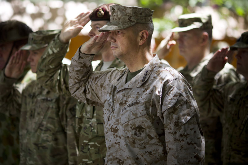 Gen. John Allen, center, the top U.S. commander in Afghanistan, salutes before he observes Memorial Day by reading a letter written by an American soldier to his family before he died earlier this year, at the ISAF headquarters in Kabul, Afghanistan, Monday, May 28, 2012.