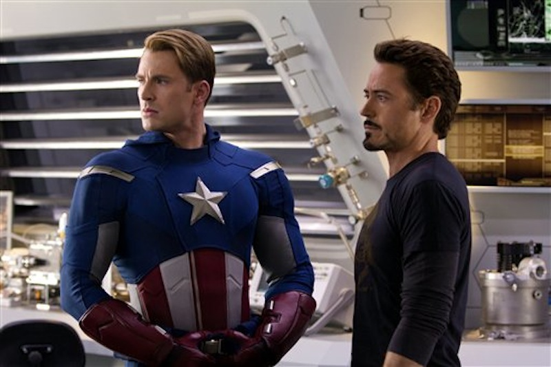 In this film image released by Disney, Chris Evans, portraying Captain America, left, and Robert Downey Jr., portraying Tony Stark, are shown in a scene from