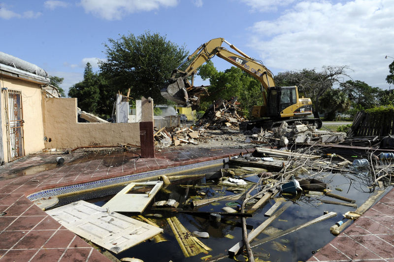 The city of Fort Lauderdale demolishes a house last month after deeming it an unsafe structure. The house had been in foreclosure limbo with the former CitiFinancial, now OneMain Financial, for more than three years. krt2012 krtusbusiness krtmacroecon macroeconomics macro economics BNK FIN REA krtnational national krtedonly 04000000 04008001 krtbusiness business debt market krtrealestate real estate mortgage 04004003 central bank krtmarket market 04008003 u.s. us united states mct krtnamer north america 04008021 04008002 consumer issue krtconstruction construction property krtbank banking bank 04008022 loan 2012