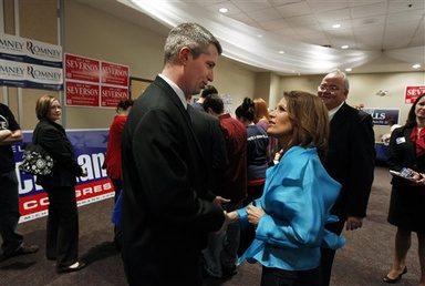 Minnesota state Rep. Kurt Bills, R-Rosemount, meets U.S. Rep. Michele Bachmann during a GOP U.S. Senate candidate forum in Mounds View, Minn., held in April. Bachmann has been granted citizenship in Switzerland.