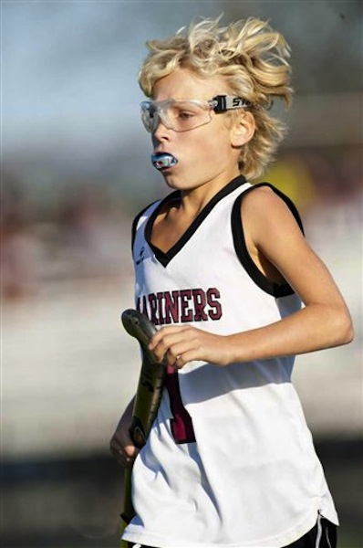 In an Oct. 21, 2011 photo, Keeling Pilaro, 13, is seen on the field as a member of the Southhampton High School Girls' Varsity field hockey team during a game against Miller Place, in Southhampton, N.Y. (AP Photo/Newsday, Gordon M. Grant)
