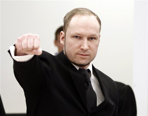 Accused Norwegian Anders Behring Breivik gestures on arrival at the courtroom, in Oslo, Norway, Wednesday April 18, 2012. Breivik detonated a bomb outside government headquarters in Oslo, killing eight people, then drove to a nearby resort island, where he massacred 69 others at a summer youth camp run by the governing Labor Party. (AP Photo/Lise Aserud/Scanpix Norway/POOL)