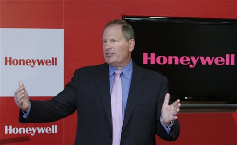 In this May 7, 2009 file photograph, Honeywell Chairman and Chief Executive Officer Dave Cote speaks after inaugurating the company's new facility in Bangalore, India. Cote is one of the top 10 highest paid CEOs at publicly held companies in America last year, according to calculations by Equilar, an executive compensation data firm, and The Associated Press. The Associated Press formula calculates an executive's total compensation during the last fiscal year by adding salary, bonuses, perks, above-market interest the company pays on deferred compensation and the estimated value of stock and stock options awarded during the year. (AP Photo/Aijaz Rahi, file)