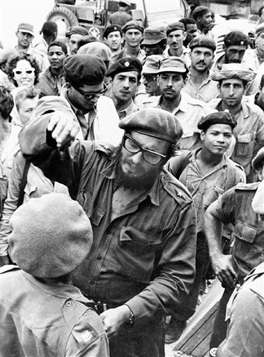 Fidel Castro, center, in an April 1961 photo with members of the Revolutionary Armed Forces at his base of operations at the Australia Sugar Refinery in Jaguey, near Playa Giron, during the Bay of Pigs invasion.