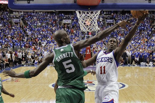 Philadelphia 76ers' Jrue Holiday, right, goes up for a shot as Boston Celtics' Kevin Garnett defends during the second half of Game 6 of an NBA basketball Eastern Conference semifinal playoff series on Wednesday The Associated Press