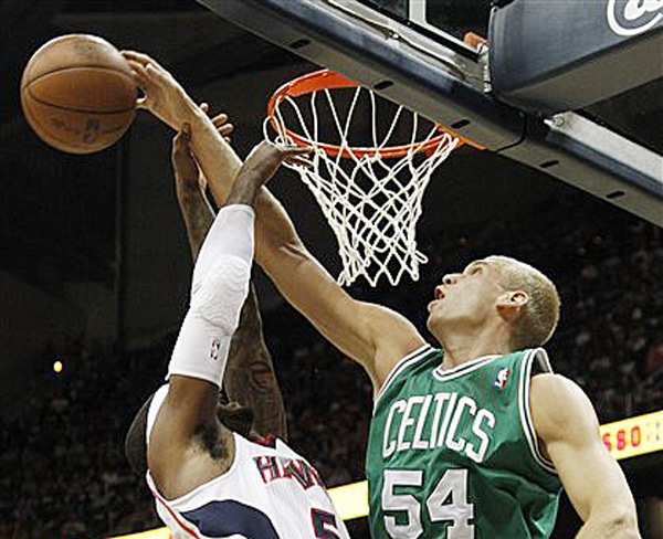 Atlanta Hawks Josh Smith has his shot blocked by Boston Celtics center Greg Stiemsma during the first half of Game 5 of playoff series game on Tuesday in Atlanta.