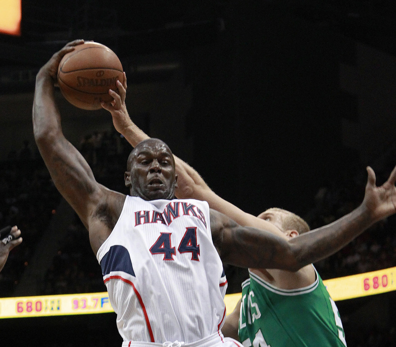 Atlanta Hawks forward Ivan Johnson (44) and Boston Celtics center Greg Stiemsma (54) vie for a rebound in the first half of Game 2 of the first-round playoff series Tuesday in Atlanta.