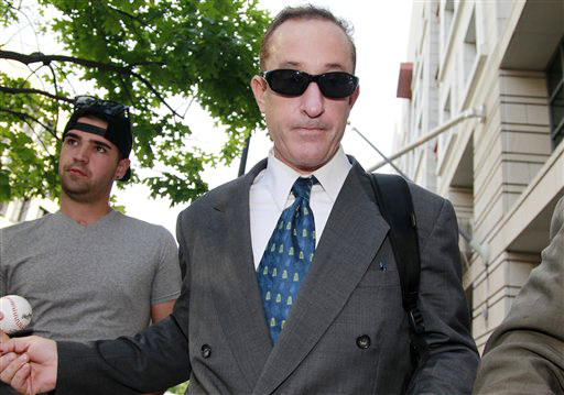 Brian McNamee, former trainer to Roger Clemens, leaves federal court in Washington on Thursday.