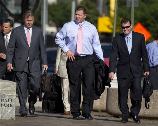 Former Major League Baseball pitcher Roger Clemens, center, arrives at federal court in Washington today.