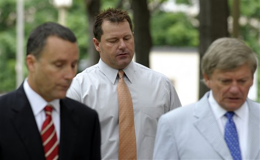 Former Major League baseball pitcher Roger Clemens, center, and his legal team, arrive at federal court in Washington on Wednesday.