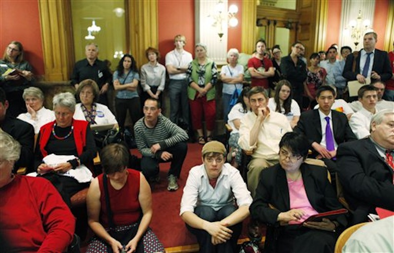 An overflow crowd listens as House Minority Leader Mark Ferrandino, sponsor of the Civil Unions bill, testifies before the House State Affairs Committee at the state Capitol in Denver on Monday, May 14, 2012. Gov. John Hickenlooper called the special session for lawmakers to vote on Civil Unions and other issues not completed when last weeks general session ended. (AP Photo/Ed Andrieski)