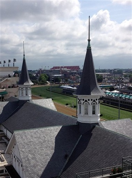 In this Saturday, May 5, 2012 photo, the twin spires at Churchill Downs are seen in Louisville, Ky. Investigators are trying to uncover clues in the mysterious death of a track worker whose body was found, Sunday, May 6, 2012, in a horse stable at Churchill Downs just a matter of hours after I'll Have Another was crowned champion of the Kentucky Derby. (AP Photo/Janet Cappiello)