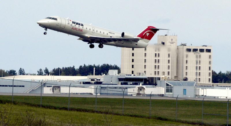 FILE- In this May 18, 2005 file photo, a passenger jet lifts off from the runway at Bangor International Airport in Bangor, Maine. Because of the airport's location at the northeastern corner of the U.S., trans-Atlantic flights confronted with terror threats or unruly passengers are often diverted to Bangor, population 33,000. (AP Photo/Bob DeLong)