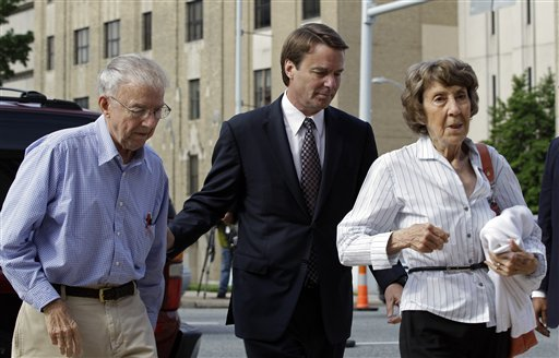 John Edwards, center, his mother Bobbie Edwards, right, and his father Wallace Edwards, left, arrive at the federal courthouse in Greensboro, N.C., today.