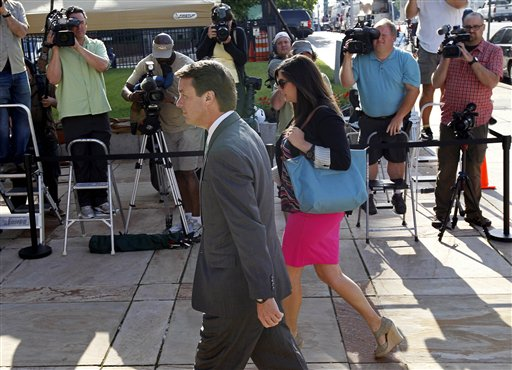 Former presidential candidate and Sen. John Edwards and his daughter Cate Edwards arrive at the federal courthouse in Greensboro, N.C., on Thursday. Edwards has pleaded not guilty to six counts related to campaign finance violations over nearly $1 million from two wealthy donors used to help hide the Democrat's pregnant mistress as he sought the White House in 2008.