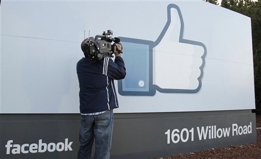 A television cameraman shoots the Like sign outside of Facebook headquarters in Menlo Park, Calif., today.